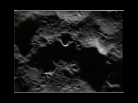 Impact site is below and to the left of the prominent crater (center). NASA photo.